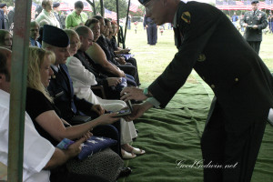 A U.S. Army representative presents the purple heart to Spc. Braden Long's mother at the close of his funeral at the raveside service for Spc. Braden Joseph Long  Aug. 19, 2007, at Cedarlawn Memorial Park in Sherman.